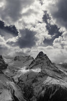 Black and white view on snowy evening mountains