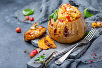 Ripe pumpkin baked with couscous and vegetables.