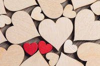 Two wooden painted red hearts