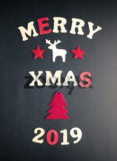 Merry xmas 2019 on a chalkboard