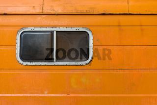 The orange old caravan with the plastic window