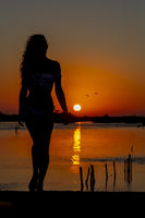 Hispanic Brunette Model Enjoying An Early Morning Sunrise