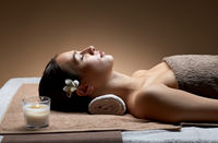 young woman lying at spa or massage parlor