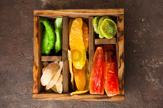 Various dried fruits in a wooden box, top view