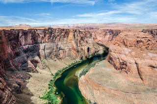 Scenic shot of Colorado river flowing through the Grand Canyon in desert landscape