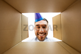happy man opening parcel box or birthday gift
