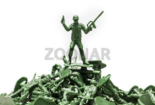 Green plastic soldiers on white background