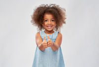little african american girl showing thumbs up