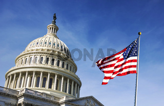 American flag waving with the Capitol Hill