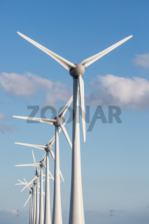Row of wind turbines and blue sky