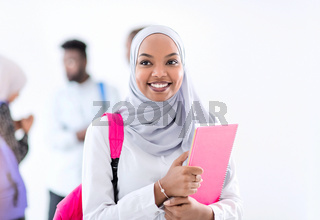 portrait of african female student with group of friends