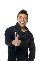 Attractive happy young man smiling, doing thumb up sign