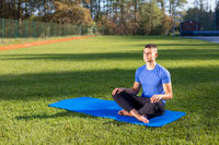 Man in park doing yoga