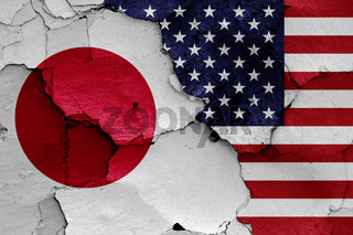 flags of Japan and USA painted on cracked wall