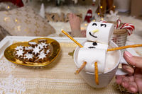Merry snowman of marshmallow floats on a hot chocolate at Christmas