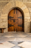 Arched door inside historic monastery in Guimaraes