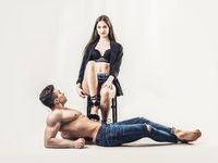 Romantic couple in studio, her dominating him