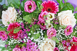 A beautiful bouquet of roses as a gift for a woman on her sixtieth anniversary macro background