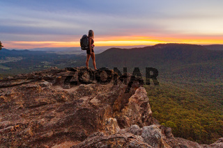 Hiker watching the last light in the mountains