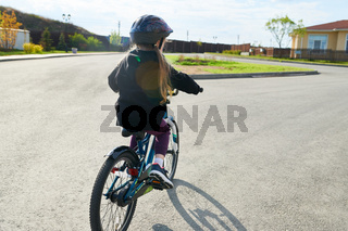 Girl Riding Bicycle in Sunlight