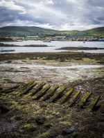 Shipwreck at the harbor of castletownbere in reland at low tide