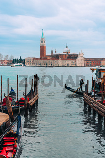 Gondolas moored by Saint Mark square