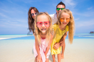 Portrait of beautiful family during summer tropical vacation