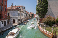 Panoramic view of Venice narrow canal with historical buildings and boats