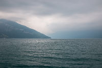 View on lake Thun and mountains from ship in city Spiez, Switzerland