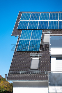 some solar panels on the roof of a private house