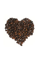 Heart shape made with some fresh roasted coffee beans isolated on white background