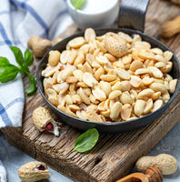 Roasted peanuts with salt in the pan.