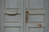 old wooden doors in the old building painted blue - gray