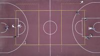 Men play basketball on the brown field. 4K video, 240fps, 2160p.