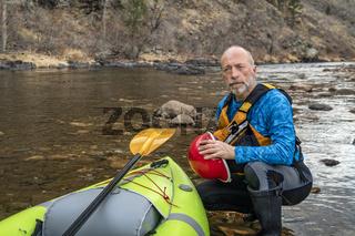 environmental portrait of a senior kayaker