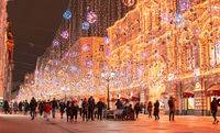 Moscow, Russia - November 27, 2019: Golden colorful rain of Christmas decorations hanging from the sky, on Nikolskaya street next to GUM in the capital. Nikolskaya street illuminated. Beautiful lights