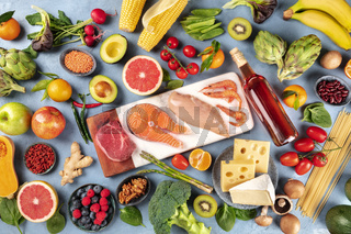 Food, overhead photo of many different products, with meat, fish, chicken and shrimps, vegetables and fruits, legumes, wine, pasta and cheese