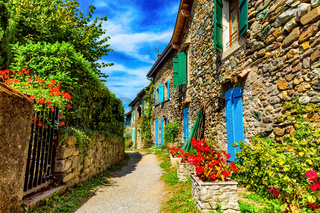 Beautiful colorful medieval alley in Yvoire town in France