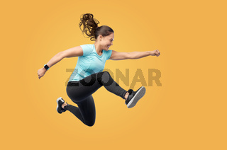 happy fit young woman jumping in air