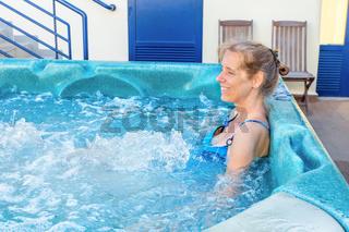 Middle aged dutch woman baths in hot tub