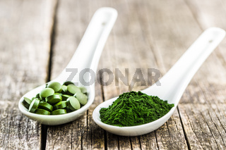 Green chlorella pills or green barley pills and powder.