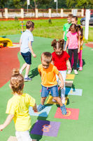 Agility and cleverness on the playground in the summer outdoors