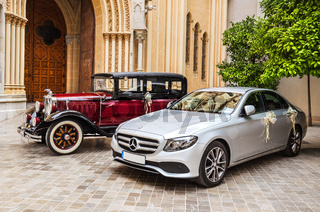 Two cars, modern and antique