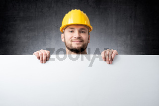 Worker holding blank board