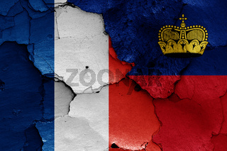 flags of France and Liechtenstein painted on cracked wall