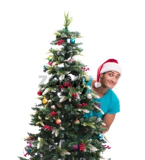 Young man decorating christmas tree isolated on white