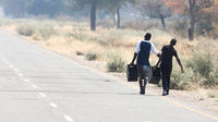 People walking at the side of the road