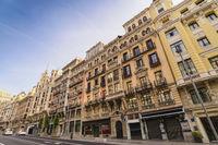 Madrid Spain, city skyline at the famous Gran Via shopping street