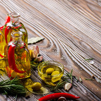Food background made of oils condiments and spices on kitchen table. Cooking concept