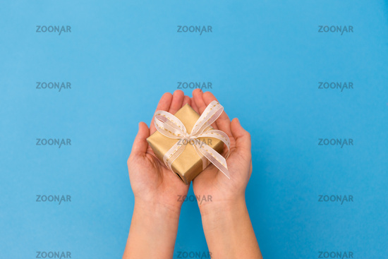 hands holding small christmas gift box